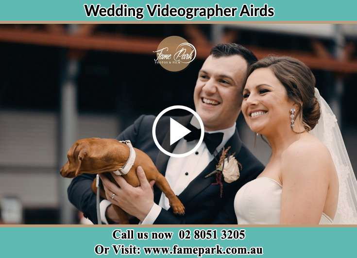 Bride and Groom with their dog at the shore Airds NSW 2560