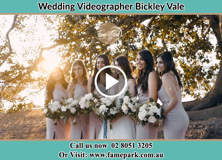 Bride and her secondary sponsors holding a bouquets of flowers at the park Bickley Vale NSW 2570