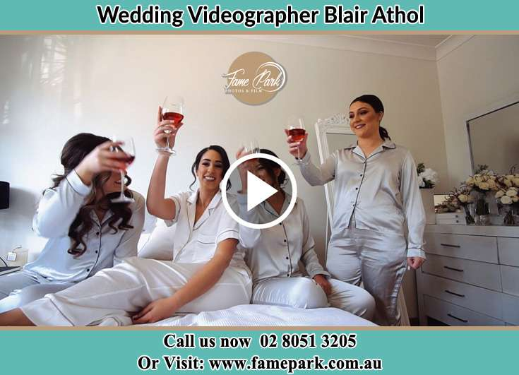 Bride and her secondary sponsors making a toast during the pajama party Blair Athol NSW 2560