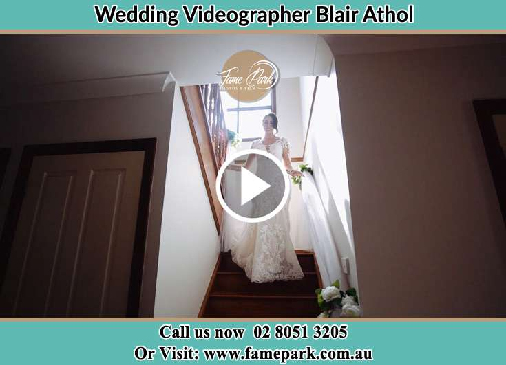 Bride walking down the staircase Blair Athol NSW 2560