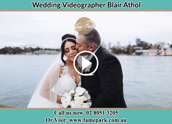 Bride and Groom kissed near the shore Blair Athol NSW 2560