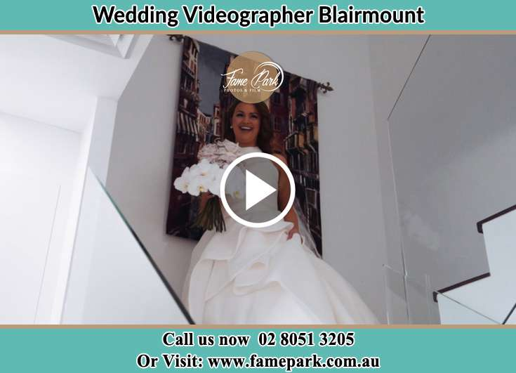 Bride walking down the staircase Blairmount NSW 2559