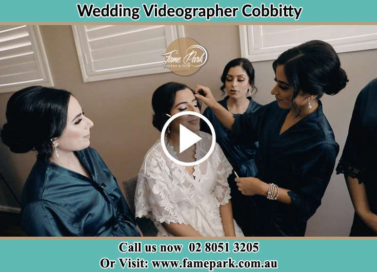 Bride getting her make up done with her secondary sponsors Cobbitty NSW 2570