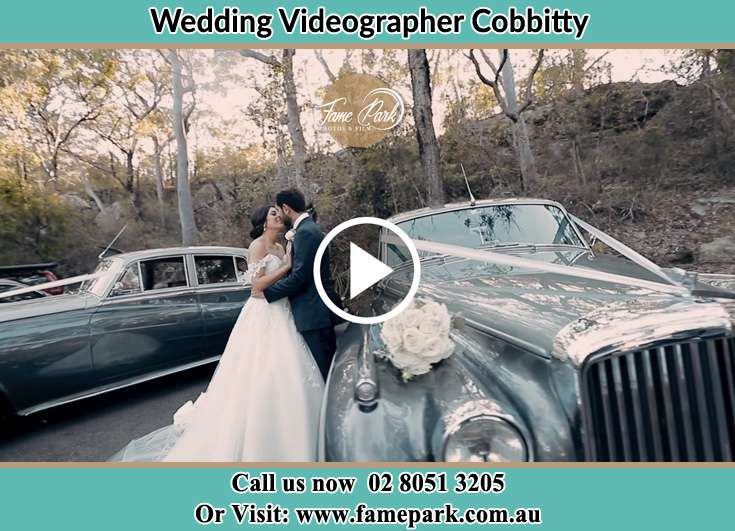Bride and Groom kissed besides their bridal car Cobbitty NSW 2570