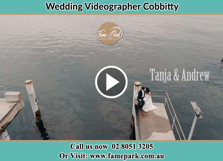 Bride and Groom kissed while sitting at the bay walk Cobbitty NSW 2570