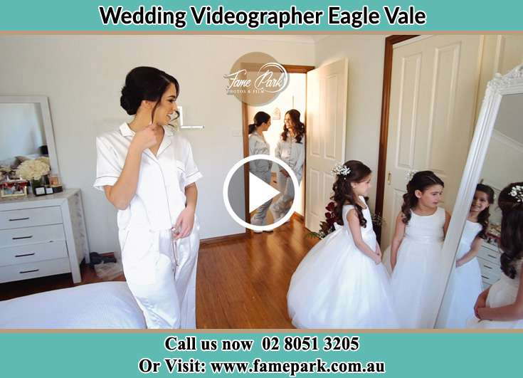 Bride looking at the mirror with her secondary sponsors Eagle Vale NSW 2558
