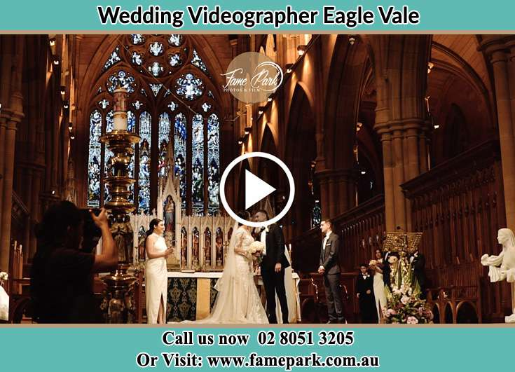 Bride and Groom kissed at the altar during the ceremony Eagle Vale NSW 2558