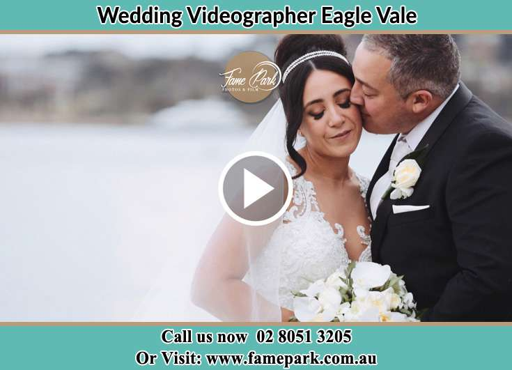 Bride and groom kissed near the bay Eagle Vale NSW 2558