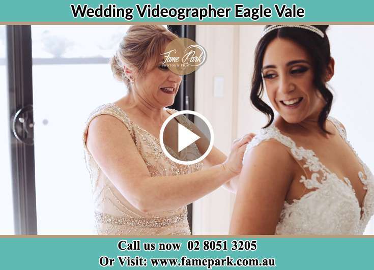 Bride getting her gown fixed Eagle Vale NSW 2558