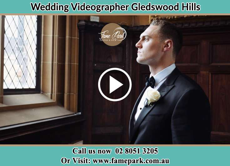 The Groom looking at the window Gledswood Hills NSW 2557