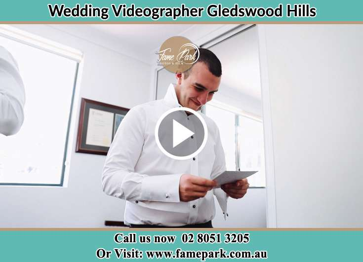 The Groom reading a note Gledswood Hills NSW 2557