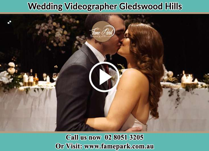 The newlyweds kissing Gledswood Hills NSW 2557