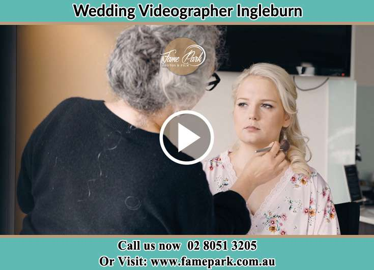 A woman applying makeup to the Bride's face Ingleburn NSW 2565