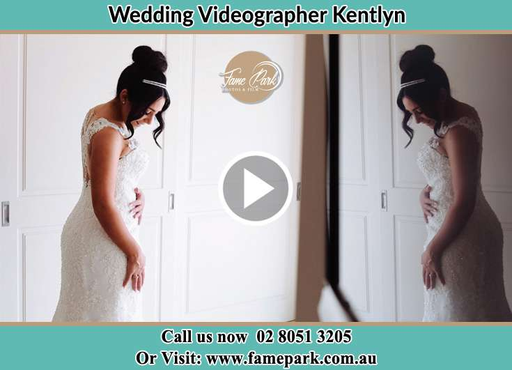 The Bride checking on her wedding dress Kentlyn NSW 2560
