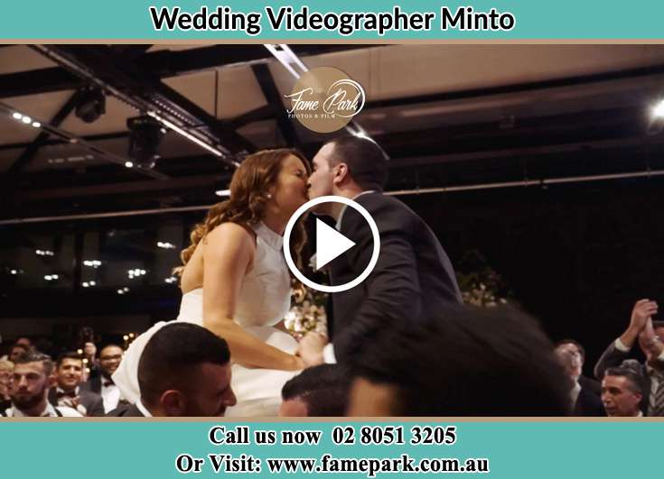 The newlyweds kissing Minto NSW 2566