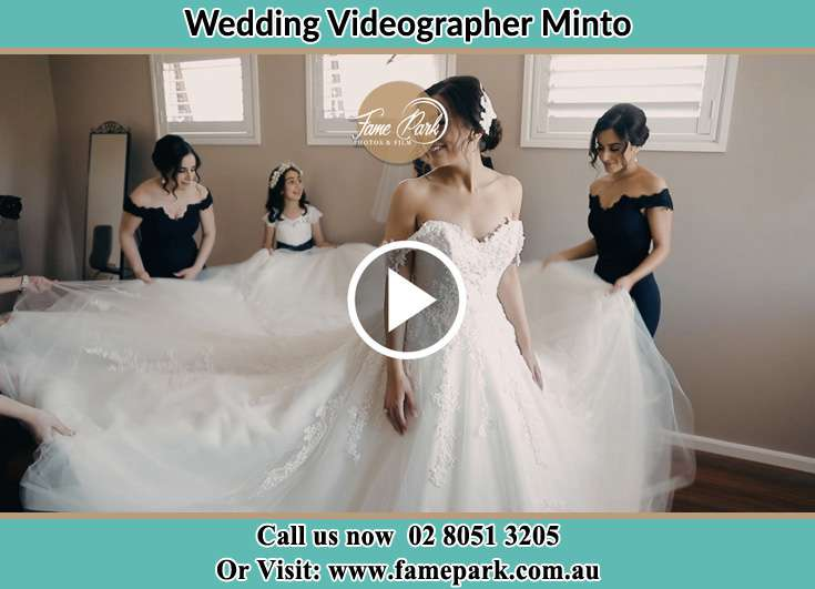 The girls spreading the Bride's wedding gown Minto NSW 2566
