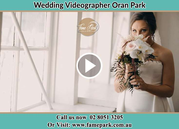 The Bride smells a bouquet of flowers Oran Park NSW 2570