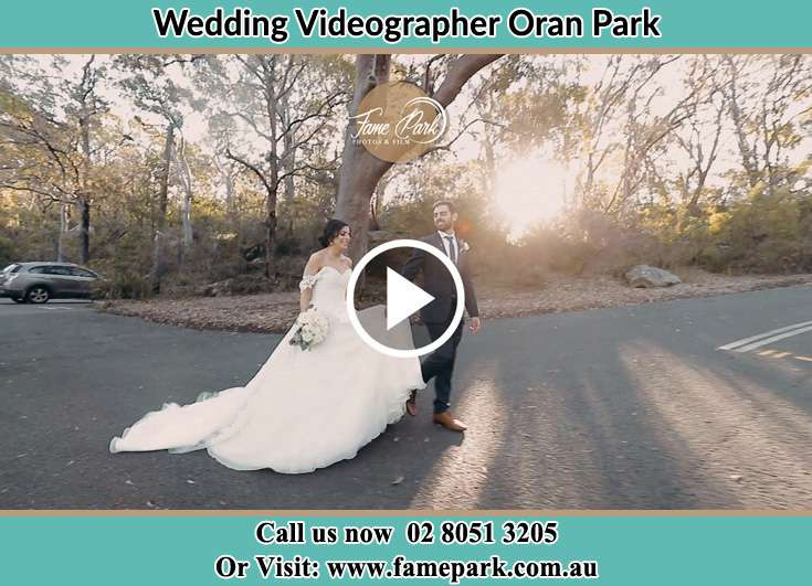 The Groom and the Bride walking in the park Oran Park NSW 2570