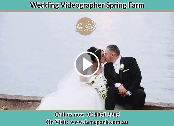 The newlyweds kissing Spring Farm NSW 2570