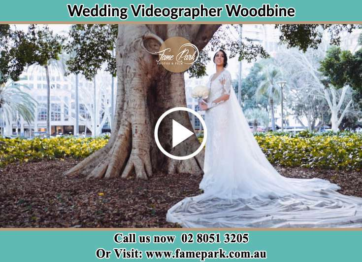 The Bride posing for the camera besides the tree Woodbine NSW 2560